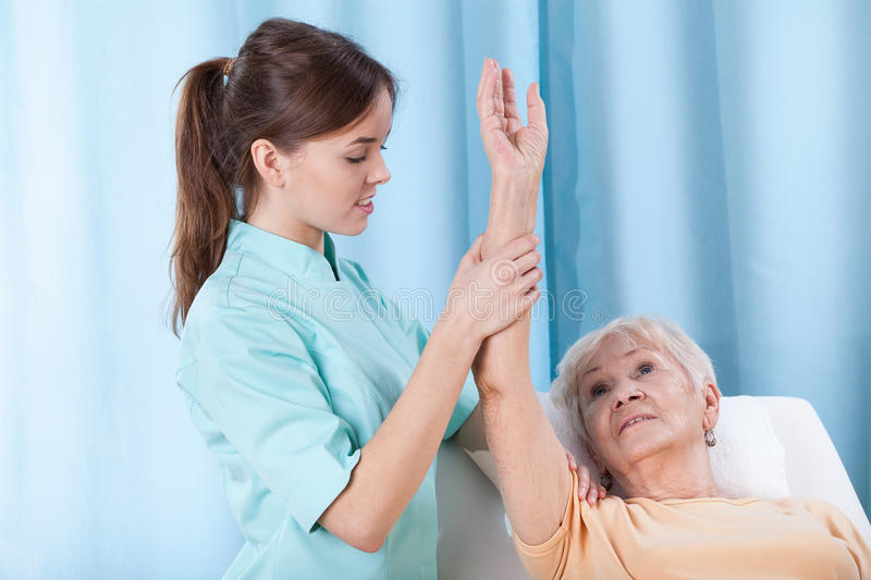 Arm rehabilitation on treatment couch royalty free stock photo