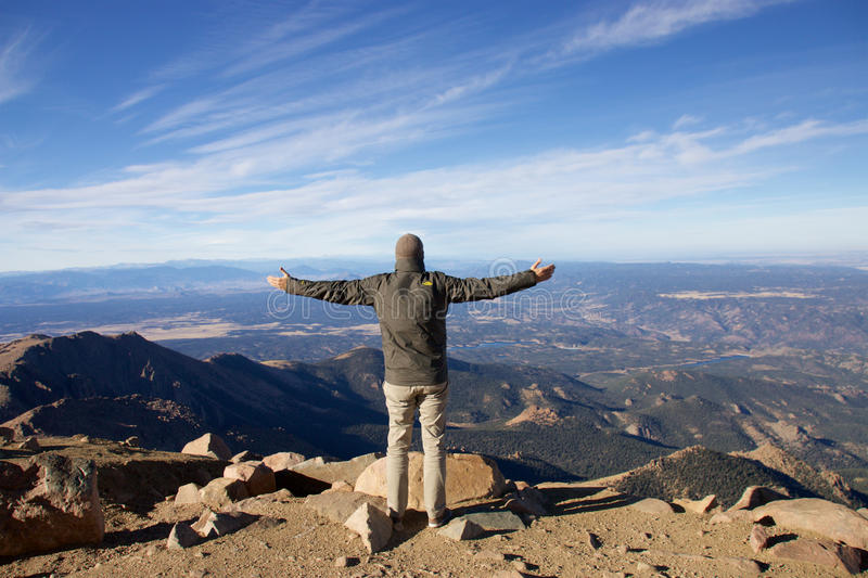 With arm wide open in the Rocky Mountains royalty free stock photos
