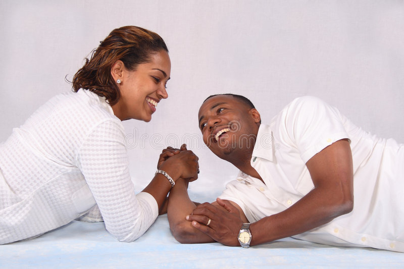Arm wrestle. An African American couple arm enjoying a good arm wrestling challenge royalty free stock photography