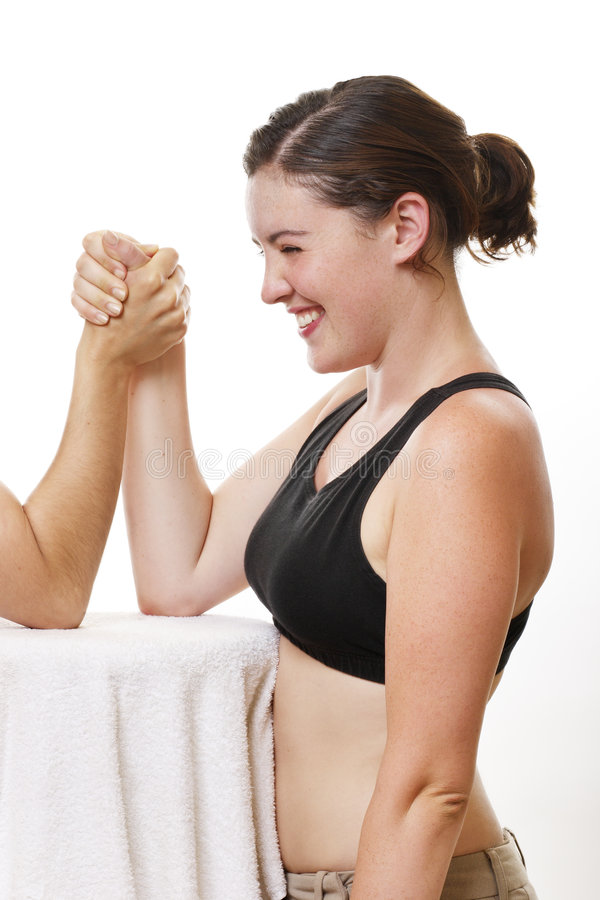 Arm wrestle. Young lady in arm wrestle stock photography