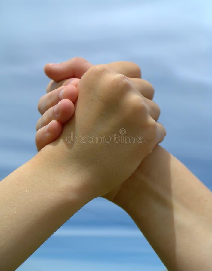 Arm Wrestling. Children arm wrestling stock image