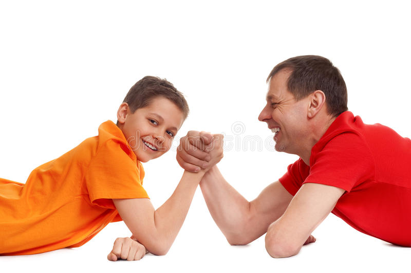 Arm wrestling. For father and son on white stock photography
