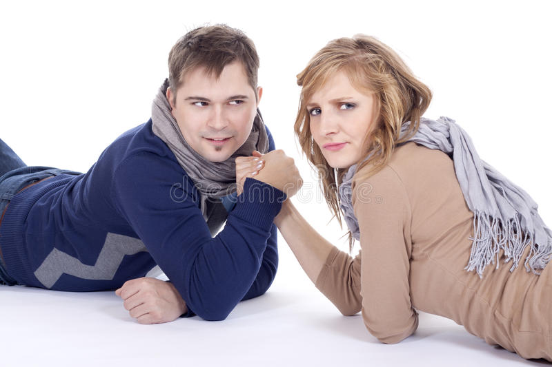 Arm wrestling. Man and women doing arm wrestling royalty free stock image