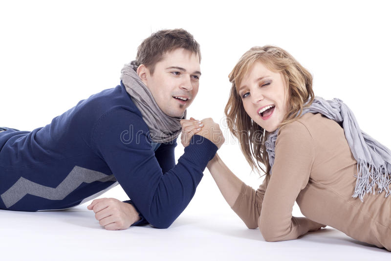 Arm wrestling. Man and women doing arm wrestling royalty free stock images