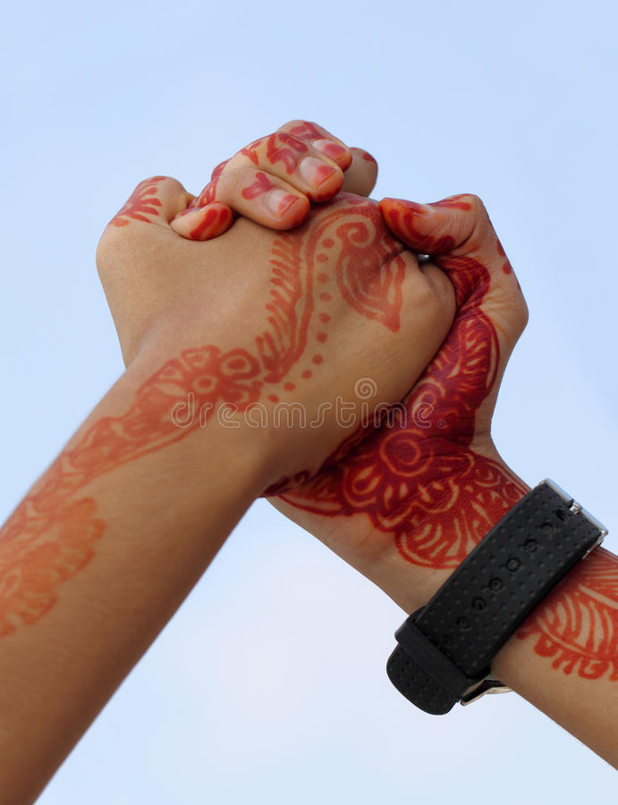 Arm wrestling. With henna tinted hand royalty free stock photography