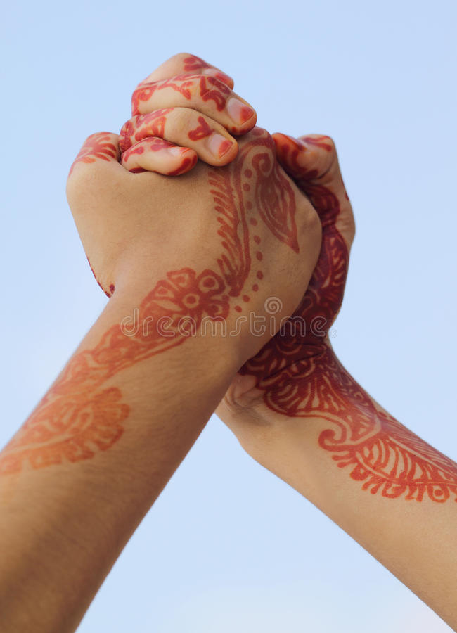Arm wrestling. With henna tinted hands royalty free stock photos
