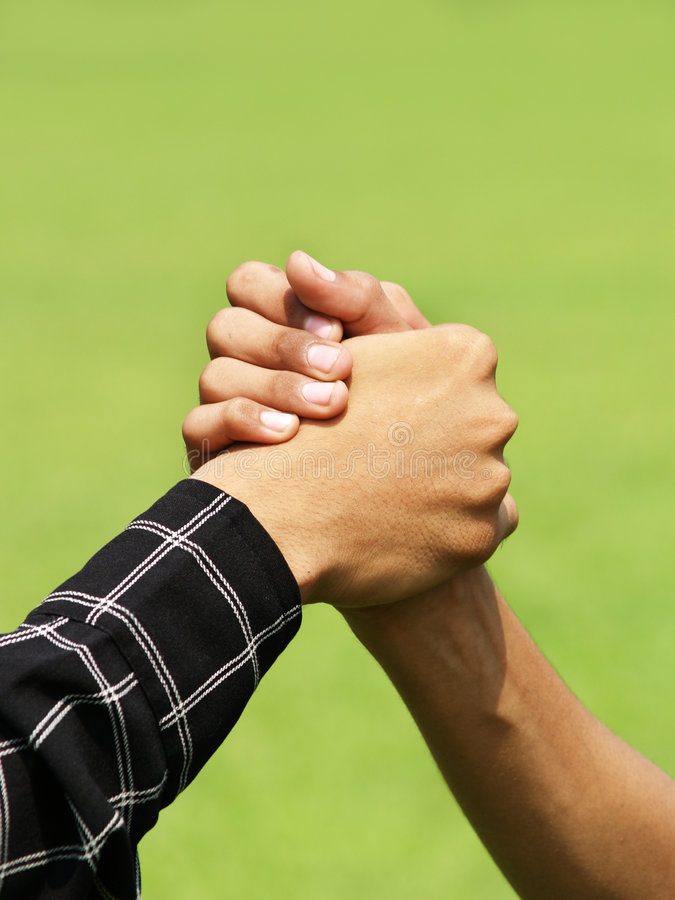 Arm Wrestling. Close-up view of a game of arm wrestling royalty free stock photo