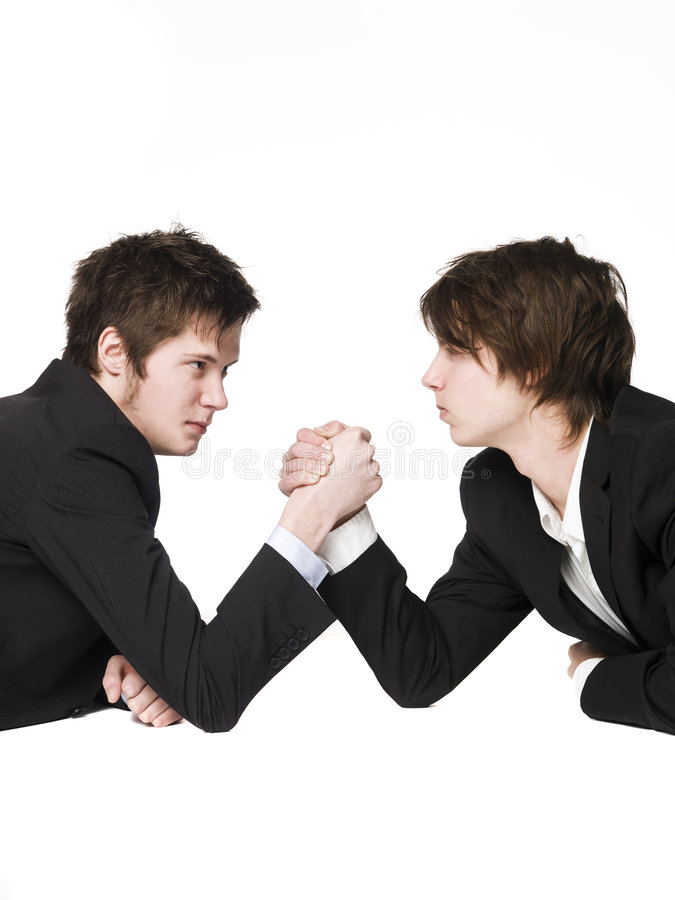 Arm wrestling. Between two men royalty free stock photos