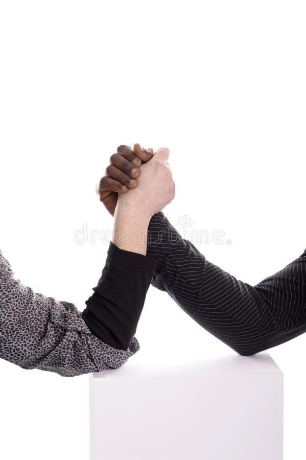 Arm wrestling between a black man and white woman stock images