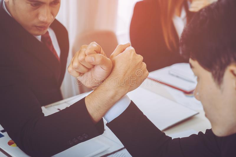 Arm wrestling in business meeting for competitive. Arm wrestling in business meeting for business competitive cocnept royalty free stock photo