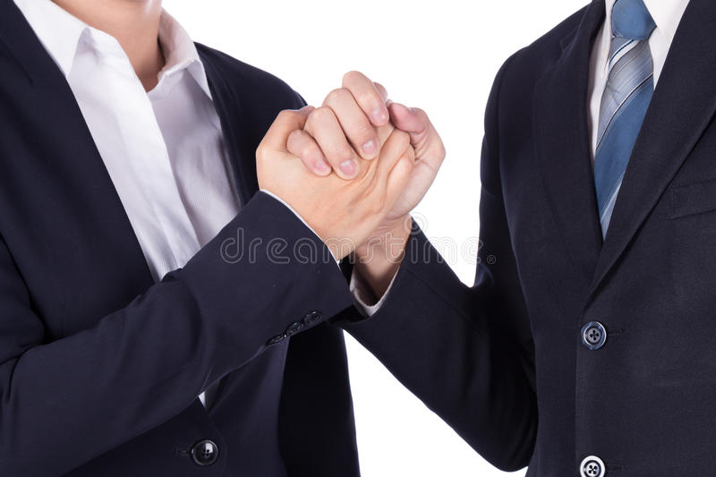 Arm wrestling between businessman and businesswoman isolated on. White background stock image