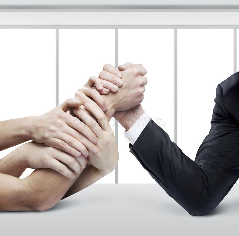 Arm wrestling. Businessman in opposition with many hands royalty free stock photos
