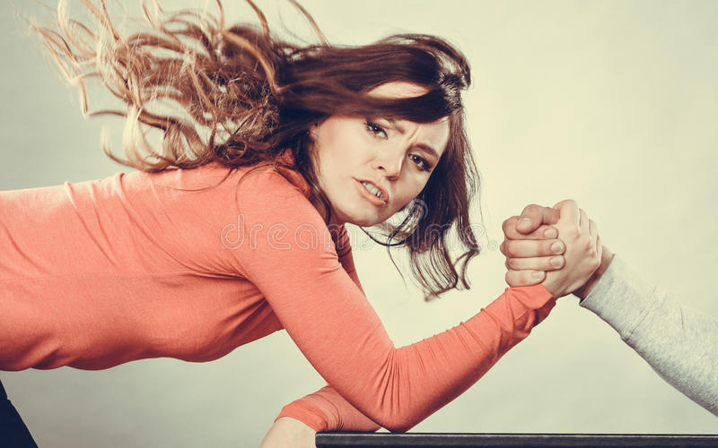 Arm wrestling challenge between young couple. Partnership relationship concept. Girlfriend confronts his boyfriend. Woman and men arm wrestling challenge between stock photo
