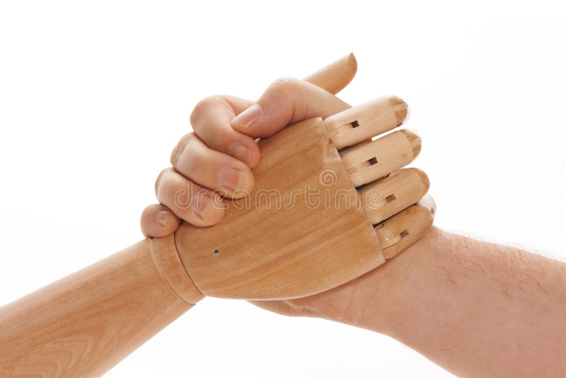 Arm Wrestling - Human Vs Machi. Mechanical wooden hand arm wrestling with man's hand stock photography
