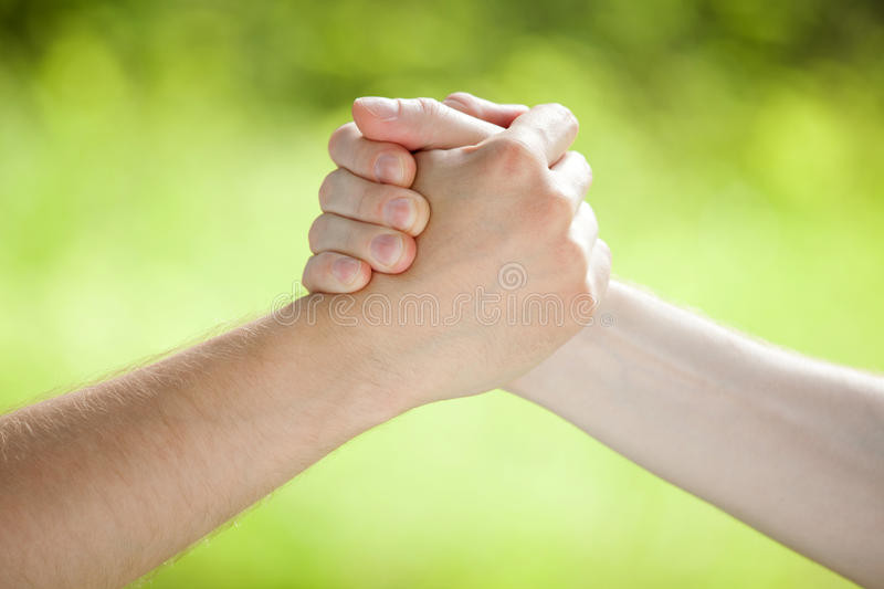 Arm wrestling. On light green background royalty free stock images