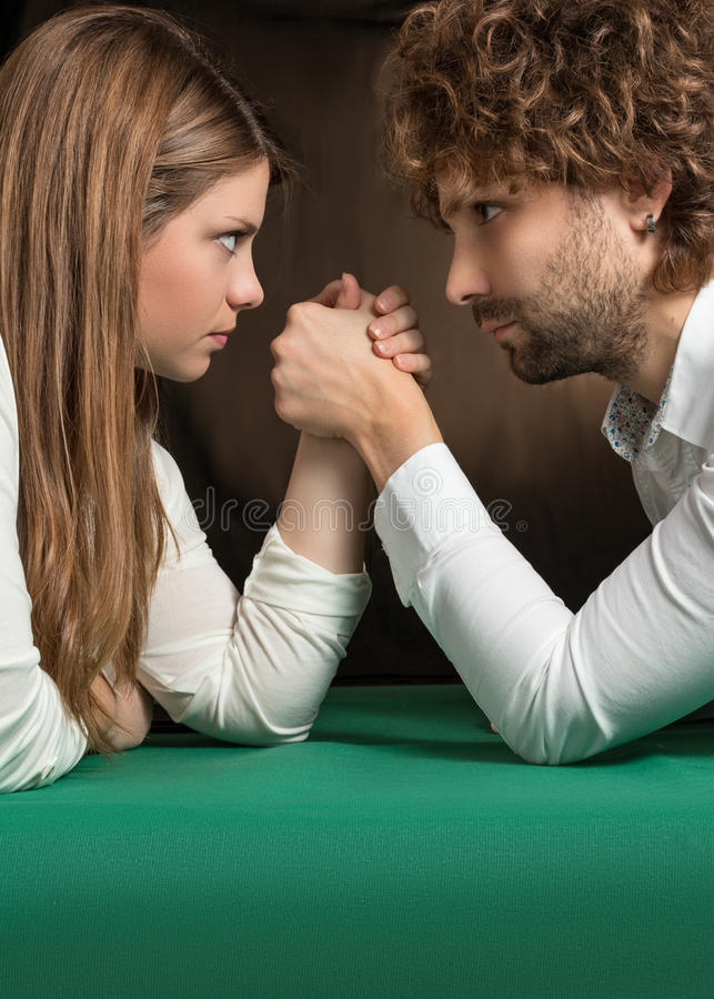 Arm wrestling between man and woman. Challenge of arm wrestling between men and woman stock photography