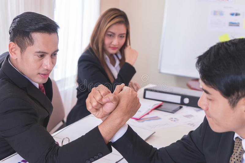 Arm wrestling in meeting for business competitive cocne. Arm wrestling in business meeting for business competitive cocnept royalty free stock photo