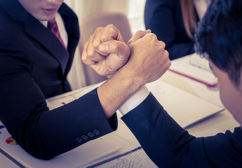 Arm wrestling in meeting for business competitive concept. Arm wrestling in business meeting for business competitive concept royalty free stock photography