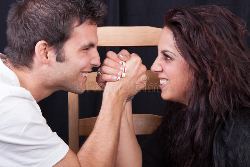 Arm wrestling. Between men and woman stock photo
