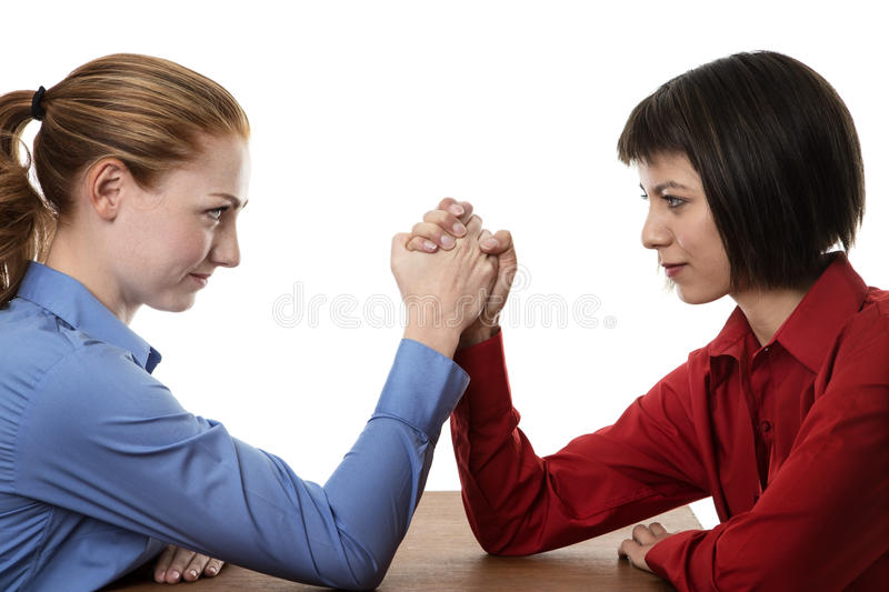 Arm wrestling. Two business women arm wrestling each other stock images