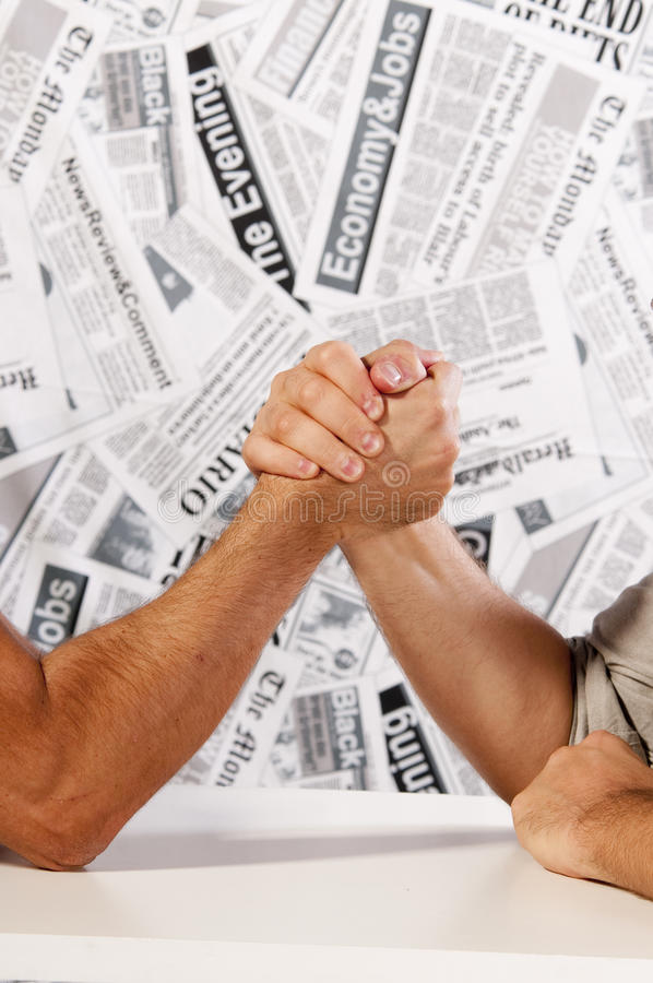 Arm wrestling,. Two men will compete in arm wrestling to win. a game of strength royalty free stock photo