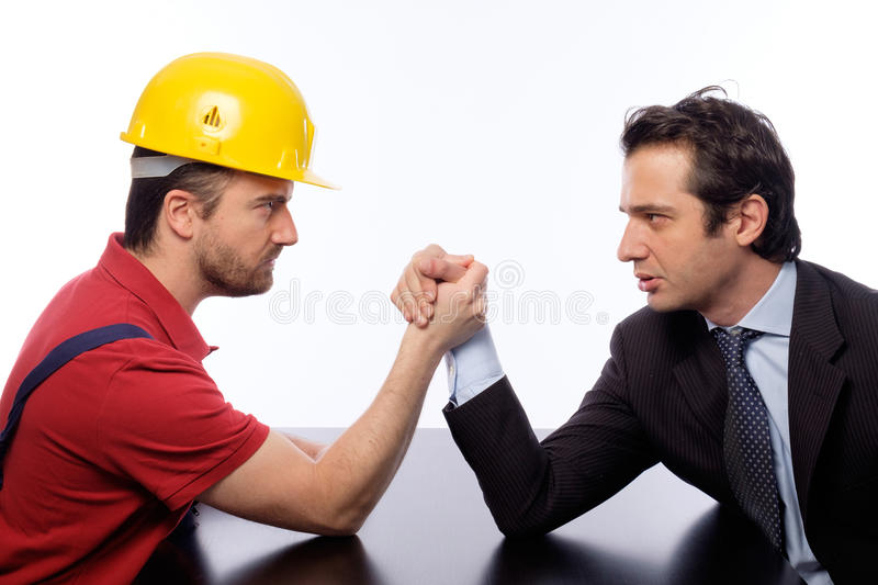 Arm wrestling white collar versus worker. Arm wrestling between white collar and worker royalty free stock images