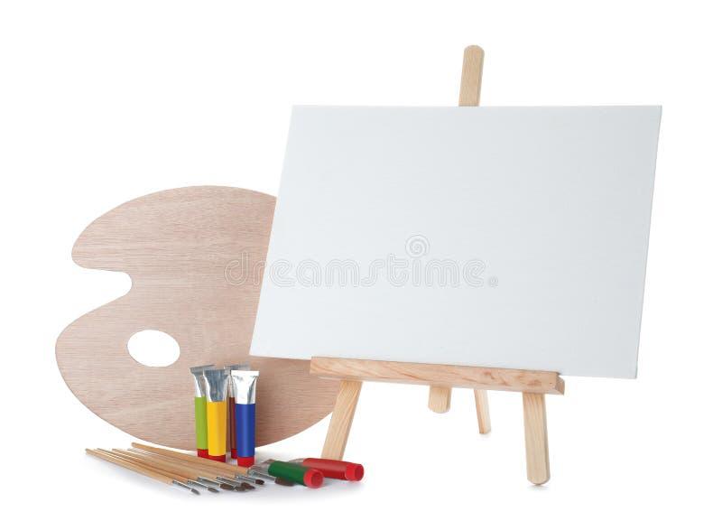 Armação de madeira com placa vazia da lona e ferramentas de pintura para crianças ilustração stock