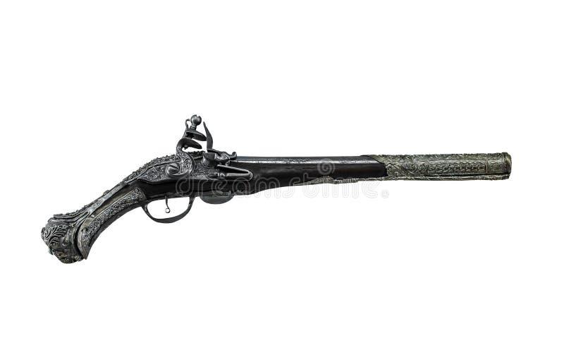 Arma antiga em um fundo branco imagens de stock royalty free