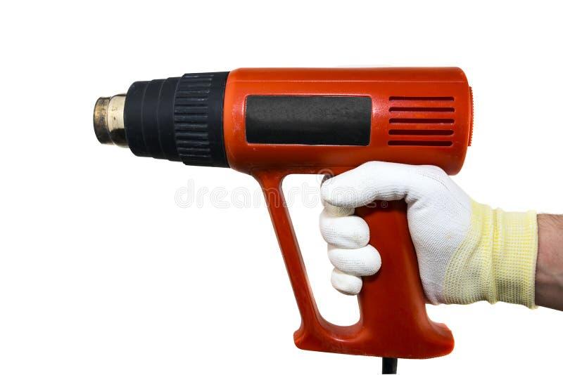 Arma de calor na mão no glowe no fundo branco isolado foto de stock