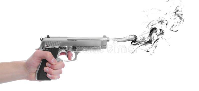Arma de la pistola con humo foto de archivo libre de regalías