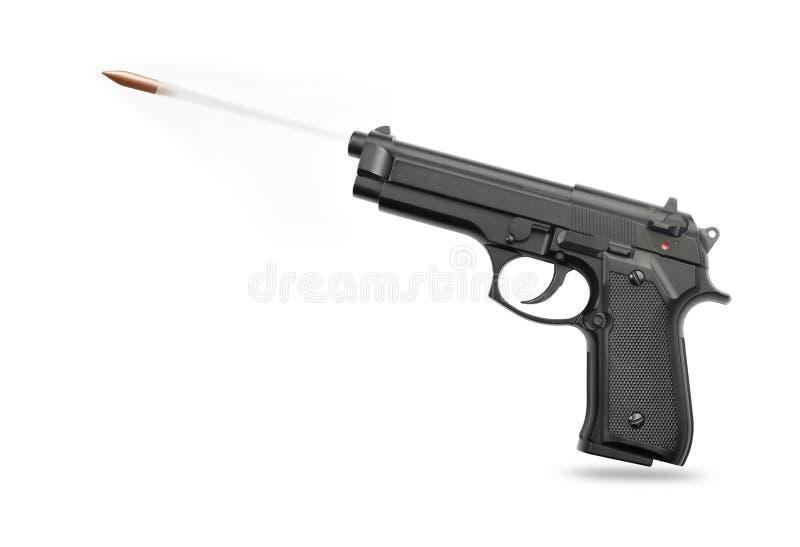 Arma de mano con la bala fotos de archivo