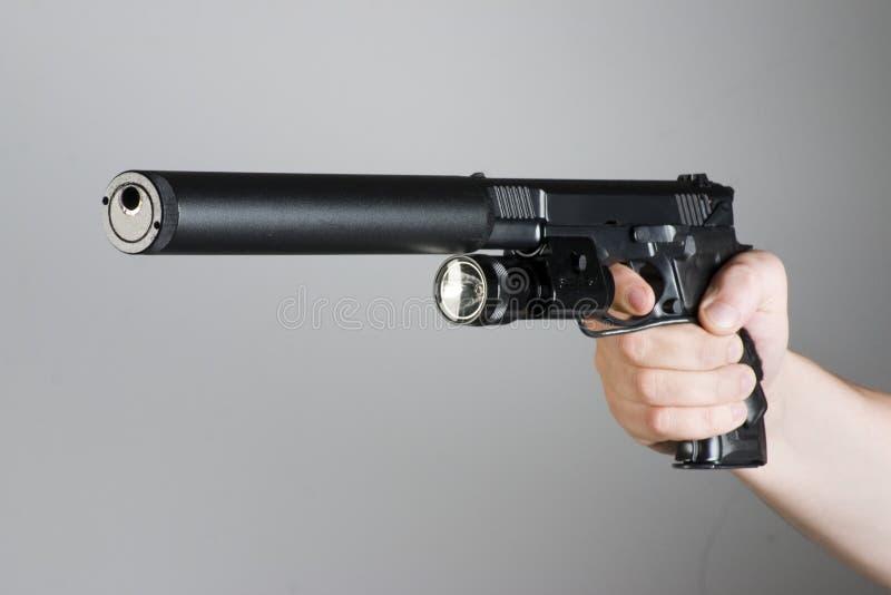 Arma de mano en la mano imagen de archivo libre de regalías
