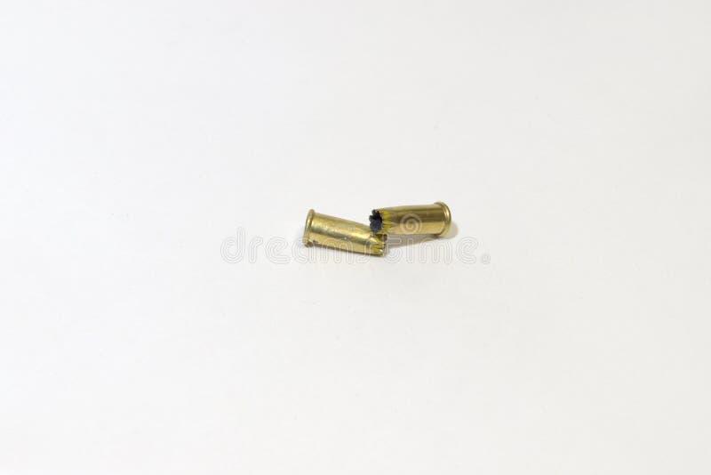 Arma del clavo de la manga del tiro munición gastada fotos de archivo