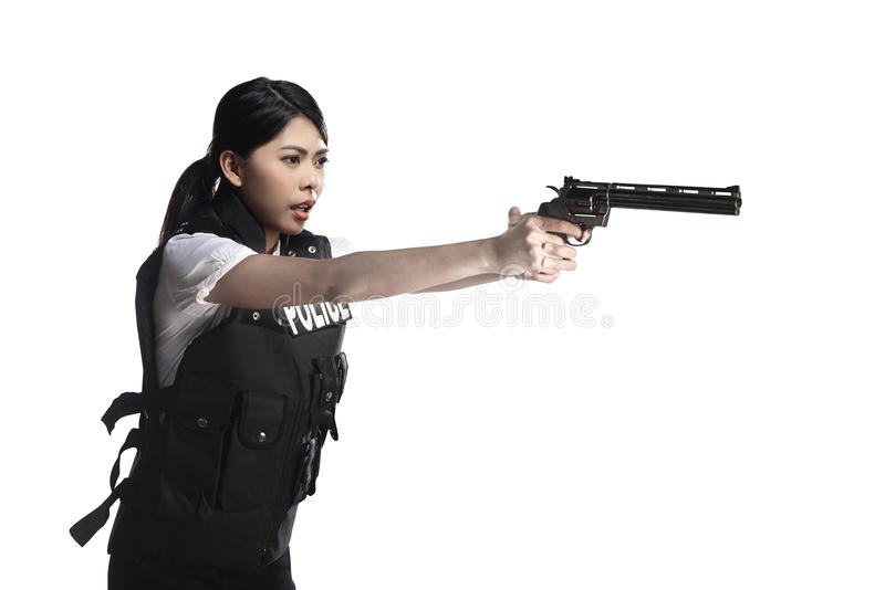 Arma del revólver del control de la mujer de la policía fotografía de archivo libre de regalías