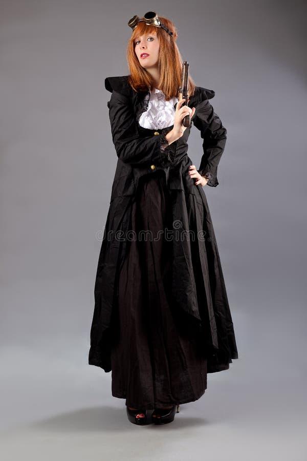 Arma dos óculos de proteção do steampunk da mulher fotografia de stock royalty free