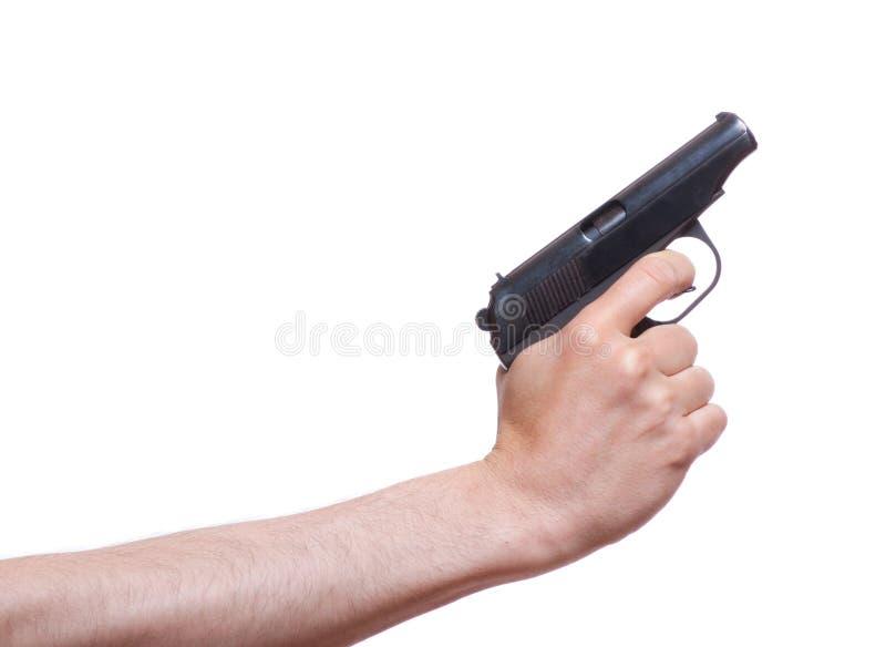 Arma en la mano del hombre foto de archivo