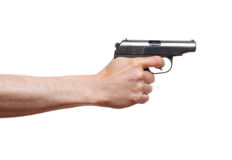 Arma en la mano del hombre fotos de archivo