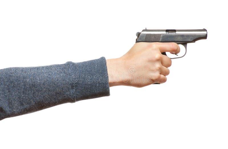 Arma en la mano del hombre imagenes de archivo