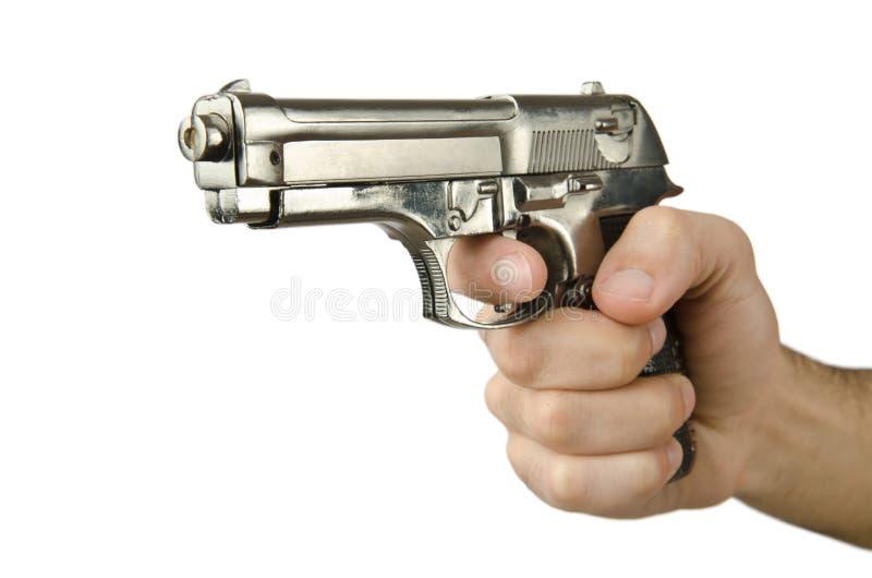 Arma en la mano en blanco fotografía de archivo libre de regalías