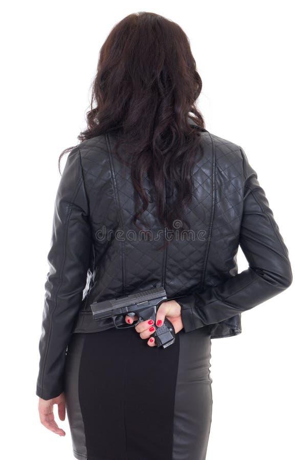 A arma escondendo da mulher atrás dela isolou-se para trás no branco fotografia de stock royalty free