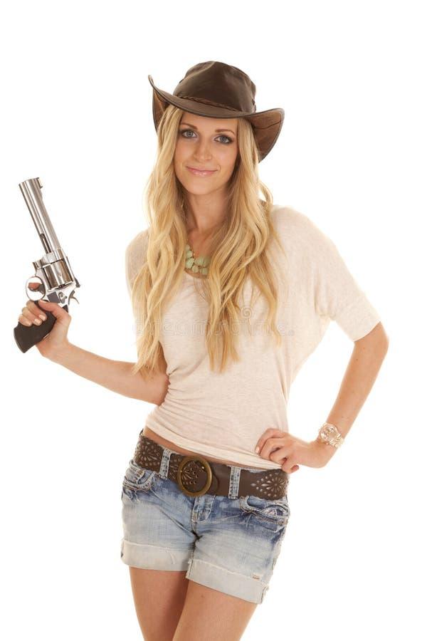 Arma leve do chapéu da camisa da mulher que sustenta o sorriso foto de stock royalty free