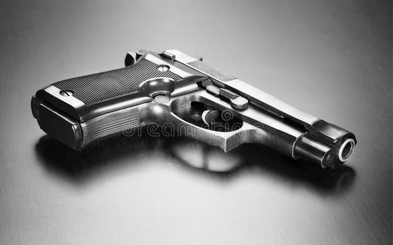 Arma oscuro fotografía de archivo