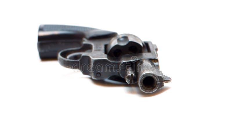 Arma sucio viejo del revólver aislado sobre blanco imágenes de archivo libres de regalías