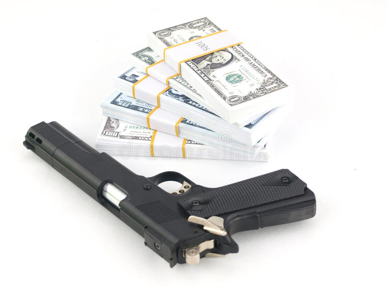 Arma y dinero fotos de archivo libres de regalías