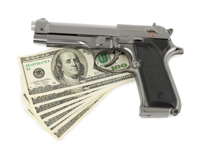 Arma y dinero imagen de archivo