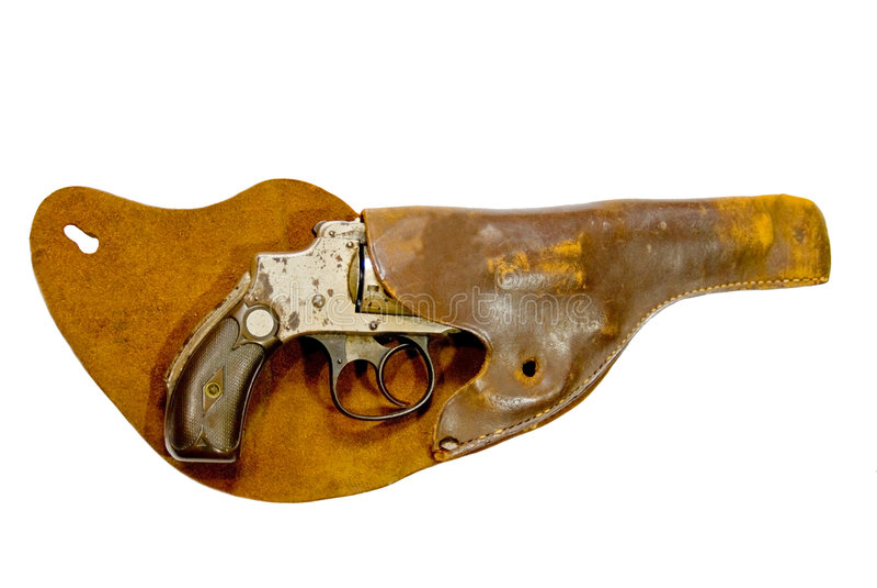 Arma y pistolera antiguos foto de archivo