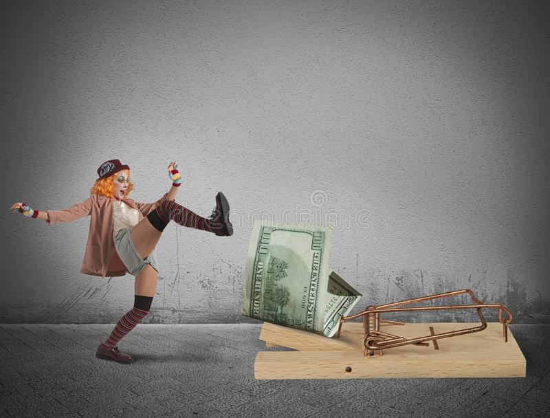 Armadilha do dinheiro do palhaço fotografia de stock
