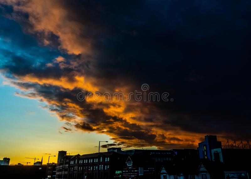Armageddon sky over Birmingham at sunset amazing. Beautiful vivid incredible intense citiscape stock photos
