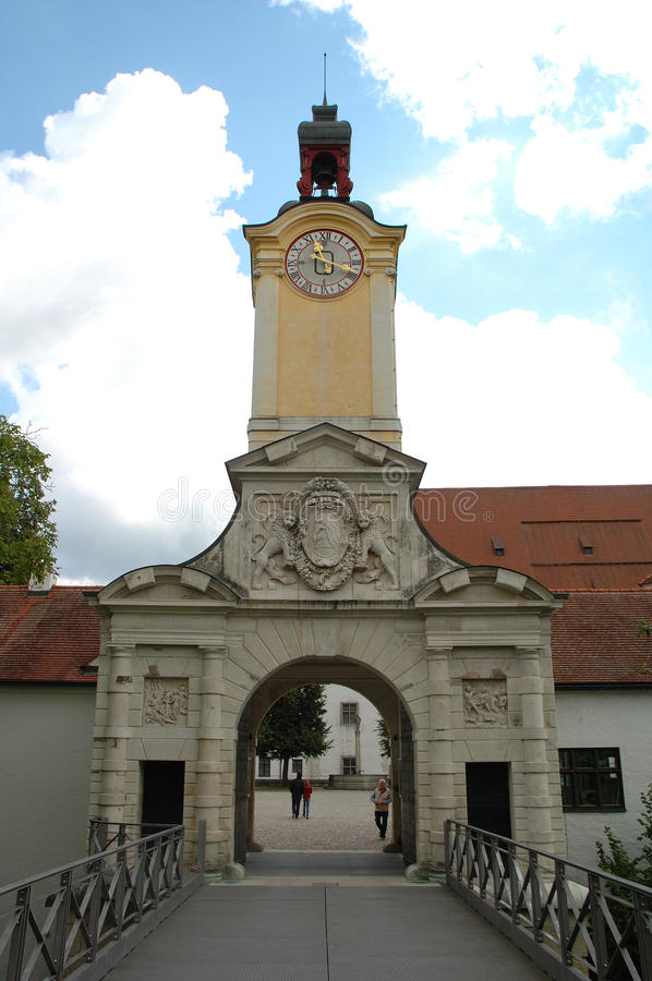Armament Museum gate in Ingolstadt in Germany. Ingolstadt, Germany - August 24, 2014: Armament Museum gate with tower and clock in Ingolstadt in Germany royalty free stock photos