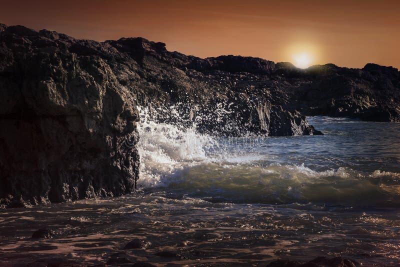 Armband-Bucht bei Sonnenuntergang Wales lizenzfreies stockbild